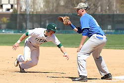 11 April 2015:  Tim Coonan dives back for first base when Sean Beal throws to Erik Schurtz during an NCAA division 3 College Conference of Illinois and Wisconsin (CCIW) Pay in Baseball game during the Conference Championship series between the Millikin Big Blue and the Illinois Wesleyan Titans at Jack Horenberger Stadium, Bloomington IL