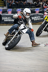 Richard Hicks races into turn one at the Flat Out Friday flat track racing on the Dr. Pepper-covered track in the UW-Milwaukee Panther Arena during the Harley-Davidson 115th Anniversary Celebration event. Milwaukee, WI. USA. Friday August 31, 2018. Photography ©2018 Michael Lichter.