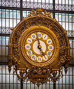 Clock on facade of Musée d'Orsay in Paris, France.  The Musée d'Orsay is a museum in Paris, France, on the left bank of the Seine. It is housed in the former Gare d'Orsay, an impressive Beaux-Arts railway station built between 1898 and 1900. The museum holds mainly French art dating from 1848 to 1915, including paintings, sculptures, furniture, and photography. It is probably best known for its extensive collection of impressionist and post-impressionist masterpieces (the largest in the world) by such painters such as Monet, Manet, Degas, Renoir, Cézanne, Seurat, Sisley, Gauguin and Van Gogh. Many of these works were held at the Galerie nationale du Jeu de Paume prior to the museum's opening in 1986.