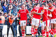 Cauley Woodrow of Barnsley (9) scores a goal and celebrates with team mates to make the score 2-1 during the EFL Sky Bet League 1 match between Barnsley and Coventry City at Oakwell, Barnsley, England on 30 March 2019.