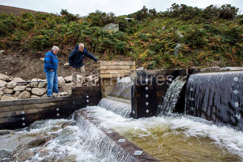 Founding directors Hywel Thomas & Gaving Gatehouse look at the intake point for Ynni Anafon Energy hydro project. One of the largest community owned hydro projects in the UK. The site of the Anafon Hydro lies in the Anafon valley in the Carneddau massif which rises immediately south of the village of Abergwyngregyn just inside the northern boundary of the Snowdonia National Park and 4 km west-south-west of Llanfairfechan. Gwynedd, North Wales.