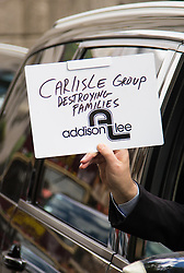 """Mayfair, London, May 24th 2016. Drivers from minicab operator Addison Lee bring traffic to a standstill in Berkely Square, outside of the offices of owner Carlyle Group, in protest against new """"unfair"""" pay rates as the company battles to compete with cut-price Uber, with some drivers claiming they are earning as little as £4.99 per hour. PICTURED: A driver claims Carlyle Group is destroying families as drivers battle to make ends meet."""