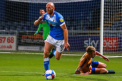 Jason Taylor of Barrow runs on the ball after getting the better of Harry Charsley of Mansfield Town - Mandatory by-line: Ryan Crockett/JMP - 27/10/2020 - FOOTBALL - One Call Stadium - Mansfield, England - Mansfield Town v Barrow - Sky Bet League Two