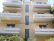 An International Style residential building at 10 Berdichevsky street, Tel Aviv was designed by Architects A. Berger and Y. Mendelbaum in 1936 Bauhaus Architecture in Tel Aviv White City. The White City refers to a collection of over 4,000 buildings built in the Bauhaus or International Style in Tel Aviv from the 1930s by German Jewish architects who emigrated to the British Mandate of Palestine after the rise of the Nazis. Tel Aviv has the largest number of buildings in the Bauhaus/International Style of any city in the world. Preservation, documentation, and exhibitions have brought attention to Tel Aviv's collection of 1930s architecture.