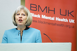 © Licensed to London News Pictures. 23/10/2014. London, UK. Home Secretary Theresa May delivering a keynote speech during Policing and Mental Health National Summit at Central Hall Westminster in London on Thursday, 23 October 2014. In her speech, Home Secretary revealed new measures to change the way police forces deal with mental health patients. Photo credit : Tolga Akmen/LNP