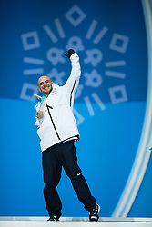 March 12, 2018 - Pyeongchang, South Korea - Bronze medalist Mike Minor of the US celebrates during a medal ceremony for Men's Snowboard Cross Monday, March 12, 2018 at the Medals Plaza for the 2018 Pyeongchang Winter Paralympic Games. Photo by Mark Reis (Credit Image: © Mark Reis via ZUMA Wire)