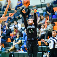 Thoreau Hawk Valentina Delgarito (14) attempts a three-point shot on the Valencia Jaguars during the Wingate Holiday Classic girls basketball tournament at Wingate High School Friday.