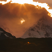 Sunset over the peaks near Mount Fitz Roy in Los Glacieres National Park, Argentina as an autumn storm clears over the mountains.