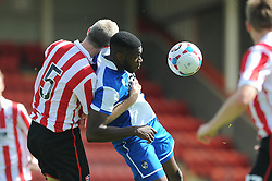 Nathan Blissett of Bristol Rovers challenges for the header with Arron Downes of Cheltenham Town - Mandatory by-line: Dougie Allward/JMP - 25/07/2015 - SPORT - FOOTBALL - Cheltenham Town,England - Whaddon Road - Cheltenham Town v Bristol Rovers - Pre-Season Friendly