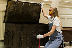 Bonhams Home and Interiors Sale Edinburgh. 06 July 2020 <br /> <br /> Pictured: Romey Clark from Bonhams with a huge 18th Century iron 'armada' chest, probably German that gives lockdown a whole new meaning. Estimate £500-£700. The Bonhams Home and Interiors sale takes place on Thursday 9 July in Edinburgh. <br /> <br /> (c) Richard Dyson | EdinburghElitemedia.co.uk 2020