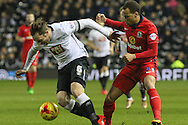 Derby County defender Richard Keogh clears the ball from Blackburn Rovers midfielder Elliott Bennett during the Sky Bet Championship match between Derby County and Blackburn Rovers at the iPro Stadium, Derby, England on 24 February 2016. Photo by Aaron  Lupton.