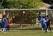 The undefeated Deportivo Colomex (Black) take on Team Shlama (Blue) during National Soccer League play in Skokie, Il.
