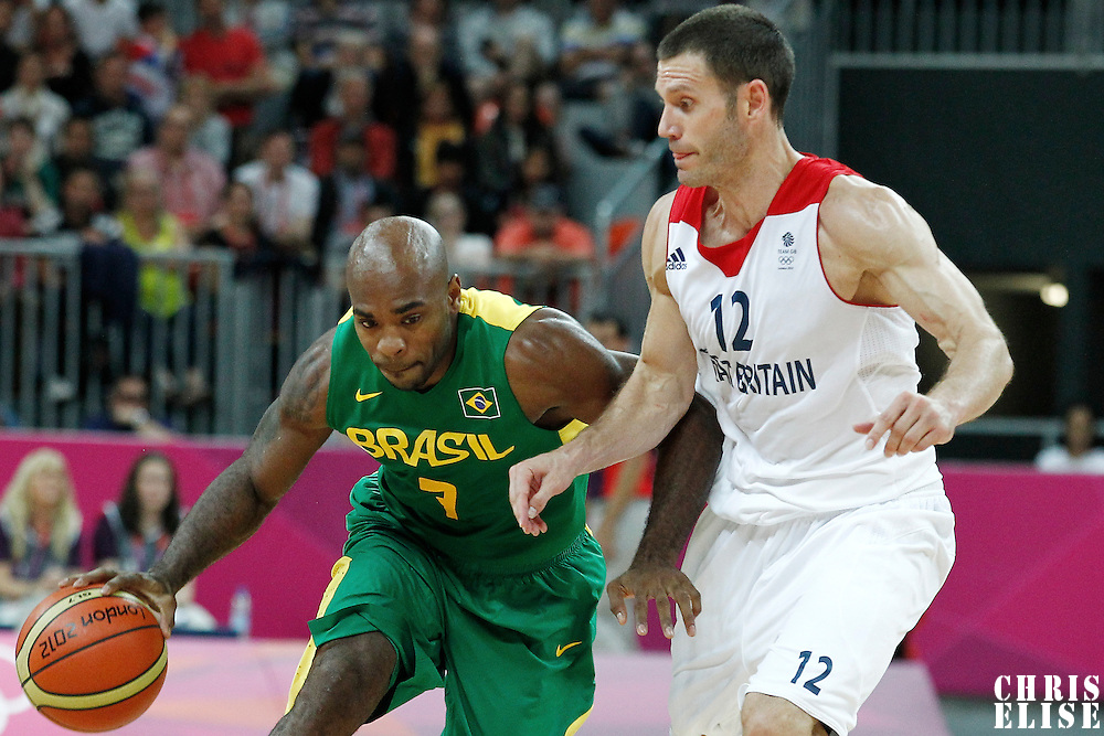 31 July 2012: Brazil Larry Taylor drives past Great Britain Nate Reinking during 67-62 Team Brazil victory over Team Great Britain, during the men's basketball preliminary, at the Basketball Arena, in London, Great Britain.