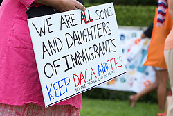 September 4, 2017 - West Palm Beach, Florida, U.S - Protesters gather at Trump Plaza in West Palm Beach for a Vigil calling President Donald Trump to continue the Deferred Action for Childhood Arrivals program, also known as DACA. (Credit Image: © Orit Ben-Ezzer via ZUMA Wire)