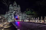 A tight squeeze through the South Gate of Angkor Thom for this fire truck.