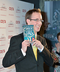 Writer NATHAN FILER winner of the Costa First Novel Award and winner of the Costa Book of the Year Award at the Costa Book Awards 2013 held at Quaglino's, 16 Bury Street, London on 28th January 2014.