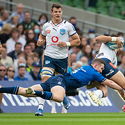 DUBLIN, IRELAND:  September 25:  Joe van Zyl #16 of the Bulls is tackled by Rory O'Loughlin #14 of Leinster during the Leinster V Bulls United Rugby Championship match at Aviva Stadium on September 25th, 2021 in Dublin, Ireland. (Photo by Tim Clayton/Corbis via Getty Images)