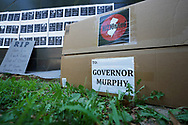 Signs are put in a box to be delivered to Governor Phil Murphy as teachers and community members from the group NJ21United, which bills themselves as a coalition of educators and community members who care about public education and public workers in New Jersey, rally Aug. 3, 2020, in front of Governor Phil Murphy's office in Trenton to advocate for holding off the reopening of schools until it's safe for everyone. (Photo by Matt Smith)