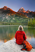 A hiker at Taggart Lake, Grand Teton National Park, Wyoming. (Model Released)