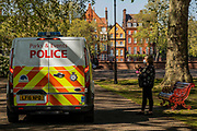 Parks Police patrol and spread the message about staying at home, not resting on benches and social distancing - Battersea Park is reasonably busy as the sun is out and it is warmer. The 'lockdown' continues for the Coronavirus (Covid 19) outbreak in London.