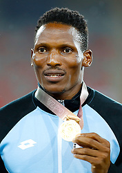 Botswana's Isaac Makwala with his gold medal won in the Men's 400m Final at the Carrara Stadium during day six of the 2018 Commonwealth Games in the Gold Coast, Australia.