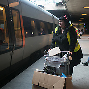 Volunteers on the read at CPH Airport train station. The train only stops briefly on the way to Sweden and the volunteers try to supply refugees on board with food and drinks in the short time they have before the doors will shut again.  An unprecedented number of refugees arrived from Germany in early September, most being Syrian war refugees, some from Afghanistan. Most wanted to travel on to Sweden and a number of Danish citizens created a spontanious network to assist the refugees with travel, food, clothes and psycological support.