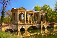 The Palladian Bridge 1774 designed by James Gibbs over the lake  in the English landscape gardens of Stowe, designed by Capability Brown. Buckingham, England .<br /> <br /> Visit our EARLY MODERN ERA HISTORICAL PLACES PHOTO COLLECTIONS for more photos to buy as wall art prints https://funkystock.photoshelter.com/gallery-collection/Modern-Era-Historic-Places-Art-Artefact-Antiquities-Picture-Images-of/C00002pOjgcLacqI