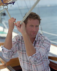 good looking man on a sailboat in San Diego, CA