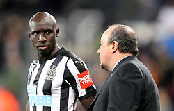 Newcastle United's Mohamed Diame (left) and manager Rafael Benitez during the Premier League match at St James' Park, Newcastle.