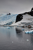 Panorama of Paradise Harbor and Brown Station (Estación Científica Almirante Brown) in Antarctica from the Deck of the Hurtigruten MS Fram. (5 of 16) Image taken with a Fuji X-T1 camera and Zeiss 32 mm f/1.8 lens (ISO 200, 32 mm, f/16, 1/500 sec). Raw images processed with Capture One Pro, Focus Magic, Photoshop CC 2015, and AutoPano Giga Pro