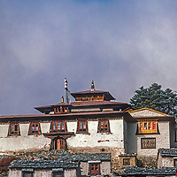 Sacred Mount Khumbila rises behind Tengboche Monastery, a spiritual center for the Sherpas of Nepal. This picture was shot in 1986 before the monastery was destroyed in an 1989 electrical fire and subsequently rebuilt in a more modern form.