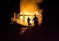 Naugatuck, Conn.- 15 August 2008- Naugatuck firefighters respond to a garage fire behind 28 Olive St. in Naugatuck...Josalee Thrift Photo