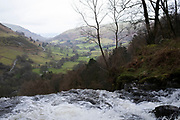 Landscape view at the top of Pistyll Rhaeadr waterfall in Llanrhaeadr-ym-Mochnant, Wales, United Kingdom. Pistyll Rhaeadr, meaning 'spring of the waterfall' is a waterfall, located a few miles from the village of Llanrhaeadr-ym-Mochnant in Powys, Wales, twelve miles west of Oswestry. Pistyll Rhaeadr is formed by water falling, in three stages, over a 240-foot cliff-face, below which the river is known as the Afon Rhaeadr.