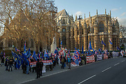 Brexit activists protest outside the Houses of Parliament on the 11th December 2018 in central London in the United Kingdom. Pro-Brexit and Anti Brexit campaigners congregate on the day of the proposed Brexit vote.