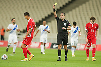 ATHENS, GREECE - OCTOBER 11: Referee Dennis Higler shows a yellow card during the UEFA Nations League group stage match between Greece and Moldova at OACA Spyros Louis on October 11, 2020 in Athens, Greece. (Photo by MB Media)