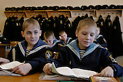 Kronstadt, Russia, 21/02/2004..11 year old Ivan Mishukov is a student at the Naval Kadetskii Korpus, the school of the elite Kronstadt Naval Academy. Abandoned by his alcoholic parents at the age of 3, Ivan lived for 2 years with a pack of wild dogs in his home town of Reutov before being rescued by police and taken to a children's home; he was subsequently adopted by Tatiana Bababina..Ivan during English language class at the school.
