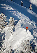 A ski patrol worker stands over the site of a small avalanche at Canyons Resort, Wednesday, Dec. 19, 2012