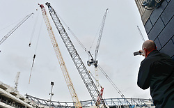 Fans take pictures of the construction site of the new stadium before the Premier League match at White Hart Lane, London.