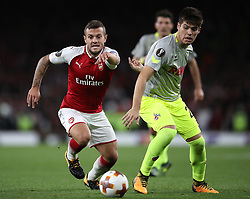 Arsenal's Arsenal's Jack Wilshere (left) in action during the Europa League match at the Emirates Stadium, London.
