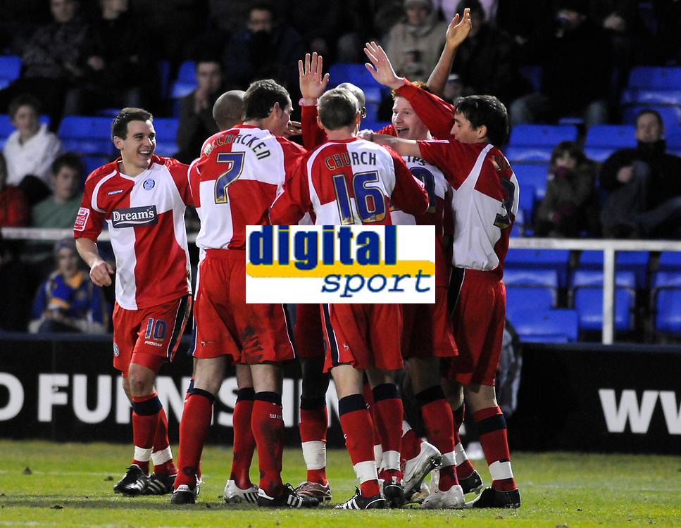 Photo: Paul Greenwood/Richard Lane Photography. Shrewbury Town v Wycombe Wanderers. Coca Cola Two. 20/12/2008. <br />Wycombe's Leon Johnson (L) laughs as team mates congratulate goal scorer Matt Harrold.