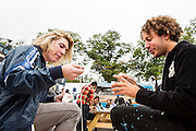 Queens, NY - October 2, 2016. Max Harwood (L) and Danny Miller of the band Lewis del Mar eating Thai noodle soup from Pata Paplean at The Feastival of Queens at The Meadows festival at Citi Field.
