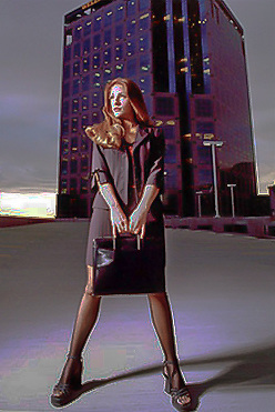 A young female executive outside a highrise office building