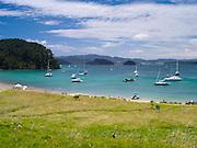 Eastward view from Motuarohia Island across the Bay of Islands. Sailboats moored.