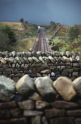 View of railway tracks from stone bridge,