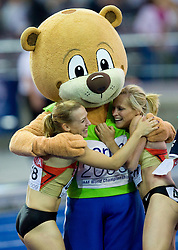 Cathleen Tschirch and Verena Sailer of Germany celebrate with mascot Berlino winning the bronze medal in the women's 4x100 Metres Relay during day eight of the 12th IAAF World Athletics Championships at the Olympic Stadium on August 22, 2009 in Berlin, Germany. (Photo by Vid Ponikvar / Sportida)