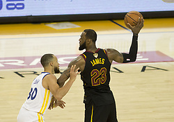 May 31, 2018 - Oakland, California, U.S - LeBron James #23 of the Cleveland  Cavaliers looks to pass   against Stephen Curry #30 of the Golden State Warriors  during their NBA Championship Game 1 at Oracle Arena in  Oakland, California on Thursday,  May 31, 2018. ARMANDO  ARORIZO/PI (Credit Image: © Prensa Internacional via ZUMA Wire)
