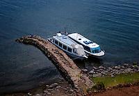TAQUILE, PERU - CIRCA OCTOBER 2015:  Tourist Boats in the Island of Taquile in Lake Titicaca.