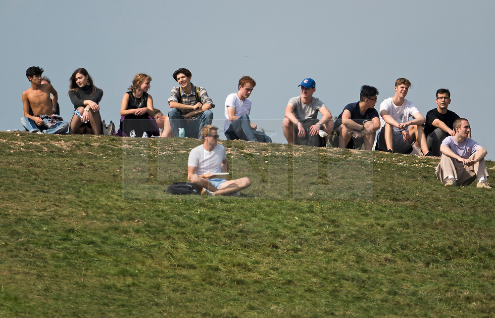 © Licensed to London News Pictures. 15/09/2020. London, UK. A group people gather on Primrose Hill in North London as large parts of the UK experience warm conditions. New Coronavirus restrictions introduced today prevent people from gathering in groups of more than six. Photo credit: Ben Cawthra/LNP