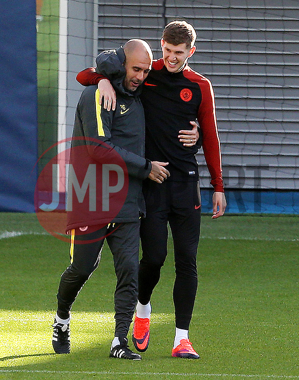Manchester City manager Pep Guardiola shares a joke with John Stones  - Mandatory by-line: Matt McNulty/JMP - 18/10/2016 - FOOTBALL - Manchester City - Training session ahead of Champions League qualifier against FC Barcelona