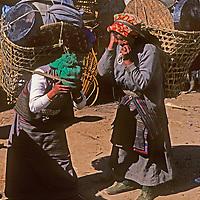 Sherpa women (Sherpanis) carry big loads for trekkers en route to Mount Everest Base Camp in Nepal's Himalaya.